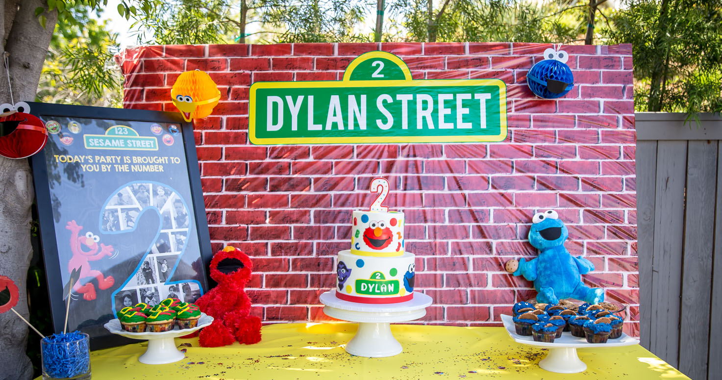 Event photography photo session 2nd second birthday party Dylan Sesame Street Elmo Cake at house in Los Angeles California 06/02/2018